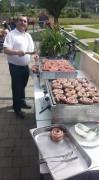 Chef beim Grillevent